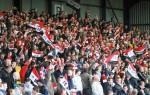 Les supporters du FC United fêteront leur anniversaire face à Benfica. (DR)
