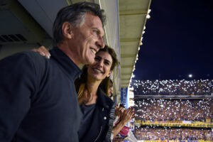 "Handout picture released by ""Cambiemos"" (Let's Change) party's press office showing Buenos Aires Mayor and presidential candidate for ""Cambiemos"" Mauricio Macri (L) and his wife Juliana Awada (R) during Argentina's first division football match between Boca Juniors and Tigre at the ""La Bombonera"" stadium in Buenos Aires, on November 1, 2015. AFP PHOTO / PRENSA CAMBIEMOS / HO --- RESTRICTED TO EDITORIAL USE - MANDATORY CREDIT ""AFP PHOTO / PRENSA CAMBIEMOS "" - NO MARKETING NO ADVERTISING CAMPAIGNS - DISTRIBUTED AS A SERVICE TO CLIENTS - GETTY OUT"